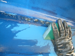 rubbing down the hull
